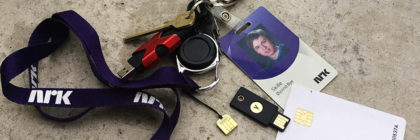 Photo of key chain with both physical keys, access card, yubikeys and smartcard